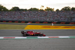 Ferrari driver Charles Leclerc of Monaco steers his car during qualifying session at the Monza racetrack, in Monza, Italy , Friday, Sept.10, 2021. The Formula one race will be held on Sunday. (AP Photo/Antonio Calanni)