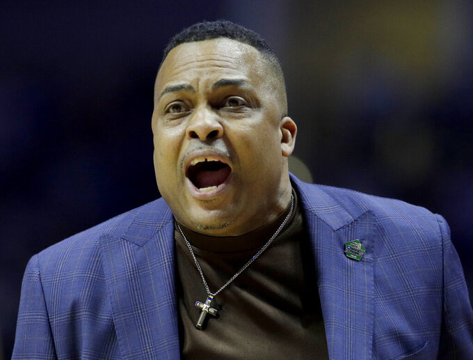 Georgia State head coach Ron Hunter talks to an official during the first half of a first round men's college basketball game against Houston in the NCAA Tournament Friday, March 22, 2019, in Tulsa, Okla. (AP Photo/Charlie Riedel)