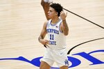 Memphis guard Lester Quinones (11) celebrates sinking a 3-point basket in the first half of an NCAA college basketball championship game against Memphis in the NIT, Sunday, March 28, 2021, in Frisco, Texas. (AP Photo/Tony Gutierrez)
