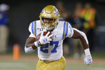 UCLA running back Joshua Kelley (27) runs for a first down against Arizona in the second half during an NCAA college football game, Saturday, Sept. 28, 2019, in Tucson, Ariz. Arizona defeated UCLA 20-17. (AP Photo/Rick Scuteri)