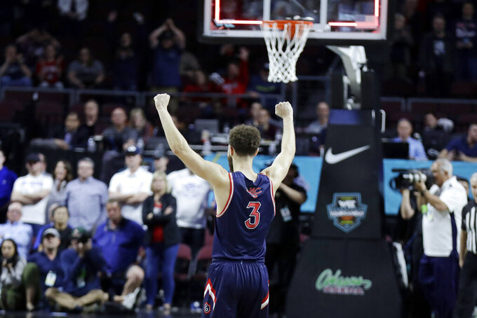 Saint Mary's Jordan Ford (3) celebrates after defeating BYU following an NCAA college basketball game in the West Coast Conference men's tournament Monday, March 9, 2020, in Las Vegas. Saint Mary's won 51-50. (AP Photo/Isaac Brekken)