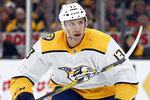 FILE  - In this Dec. 21, 2019, file photo, Nashville Predators' Nick Bonino plays against the Boston Bruins during an NHL hockey game in Boston. The Nashville Predators traded center Nick Bonino to the Minnesota Wild for forward Luke Kunin on Wednesday, Oct. 7, 2020, a swap on the second day of the NHL draft that sent two picks to the Wild and one back to the Predators. (AP Photo/Michael Dwyer, File)