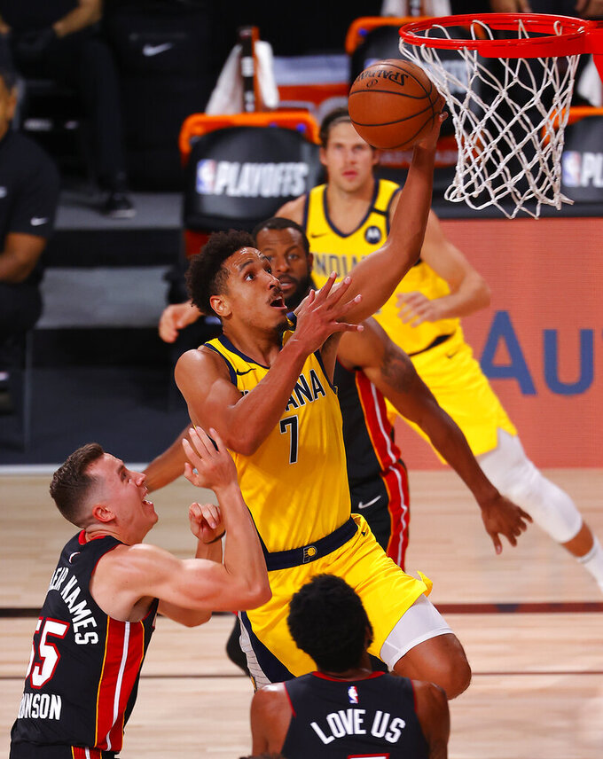 Malcolm Brogdon of the Indiana Pacers drives the ball to the basket during the second half against the Miami Heat in Game 1 of an NBA basketball first-round playoff series, Tuesday, Aug. 18, 2020, in Lake Buena Vista, Fla. (Mike Ehrmann/Pool Photo via AP)