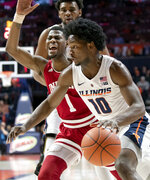 Illinois guard Andres Feliz (10) drives to the basket past Indiana guard Aljami Durham (1) during the first half of an NCAA college basketball game in Champaign, Ill., Thursday, March 7, 2019. (AP Photo/Stephen Haas)
