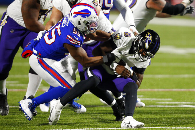 Buffalo Bills' Jerry Hughes (55) sacks Baltimore Ravens quarterback Lamar Jackson (8) during the first half of an NFL divisional round football game Saturday, Jan. 16, 2021, in Orchard Park, N.Y. (AP Photo/Jeffrey T. Barnes)