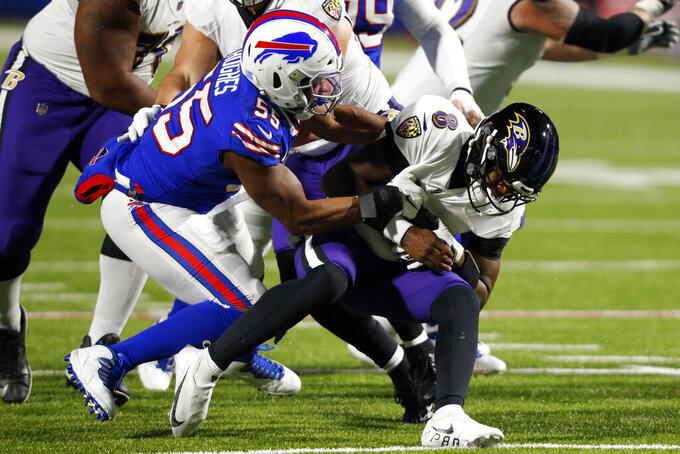 Buffalo Bills' Jerry Hughes (55) sacks Baltimore Ravens quarterback Lamar Jackson (8) during the first half of an NFL divisional round football game Saturday, Jan. 16, 2021, in Orchard Park, N.Y. (AP Photo/Jeffrey T. Barnes)