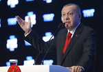 Turkish President Recep Tayyip Erdogan speaks at a forum organized by Turkish TRT World broadcaster, in Istanbul, Monday, Oct. 21, 2019. Erdogan has responded angrily to widespread criticism in the West of Turkey's incursion in northeast Syria.(Presidential Press Service via AP, Pool )