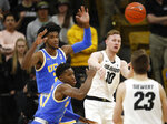 Colorado forward Alexander Strating, back, right, passes the ball to forward Lucas Siewert, front right, under defensive pressure from UCLA guards Jalen Hill, back left, and David Singleton in the first half of an NCAA college basketball game Thursday, March 7, 2019, in Boulder, Colo. (AP Photo/David Zalubowski)