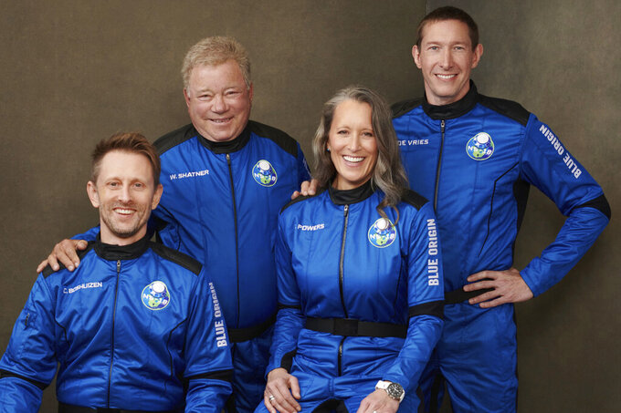 This undated photo made available by Blue Origin in October 2021 shows, from left, Chris Boshuizen, William Shatner, Audrey Powers and Glen de Vries. Their launch scheduled for Wednesday, Oct. 13, 2021 will be Blue Origin's second passenger flight, using the same capsule and rocket that Jeff Bezos used for his own trup three months earlier. (Blue Origin via AP)