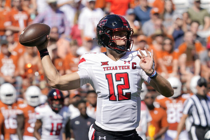 Texas Tech quarterback Tyler Shough (12) looks to pass against Texas during the first half of an NCAA college football game on Saturday, Sept. 25, 2021, in Austin, Texas. (AP Photo/Chuck Burton)
