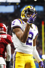 LSU wide receiver Justin Jefferson (2) celebrates a touchdown catch against Oklahoma during the first half of the Peach Bowl NCAA semifinal college football playoff game, Saturday, Dec. 28, 2019, in Atlanta.(AP Photo/John Bazemore)