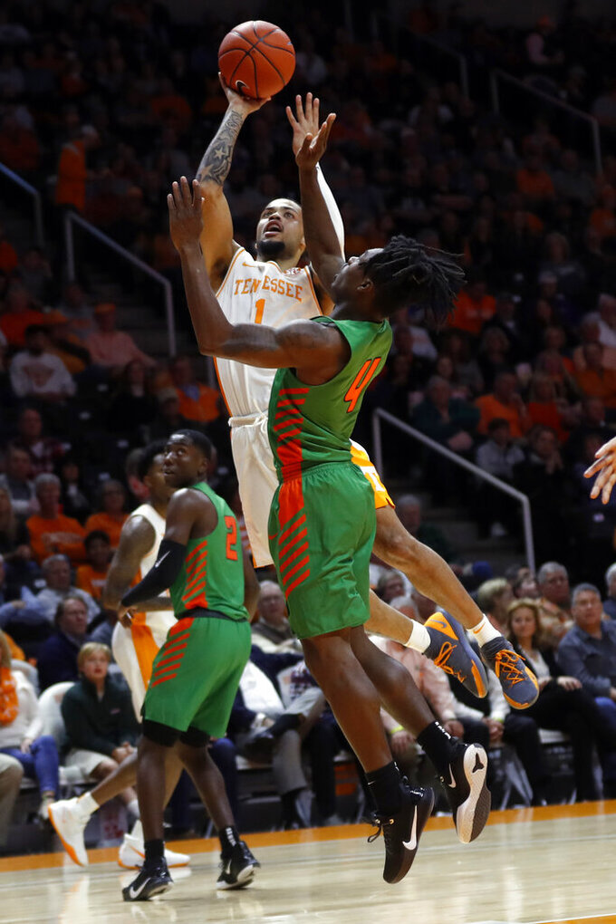 Tennessee guard Lamonte Turner (1) shoots over Florida A&M guard Rod Melton Jr. (4) during the first half of an NCAA college basketball game Wednesday, Dec. 4, 2019, in Knoxville, Tenn. (AP Photo/Wade Payne)