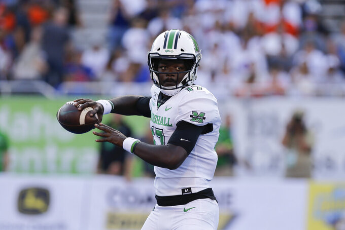 Marshall quarterback Isaiah Green looks to pass during the first half of an NCAA college football game against Boise State in Boise, Idaho, Friday, Sept. 6, 2019. (AP Photo/Otto Kitsinger)