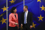 Facebook CEO Mark Zuckerberg, right, is greeted by European Commissioner for Values and Transparency Vera Jourova prior to a meeting at EU headquarters in Brussels, Monday, Feb. 17, 2020. (AP Photo/Francisco Seco)