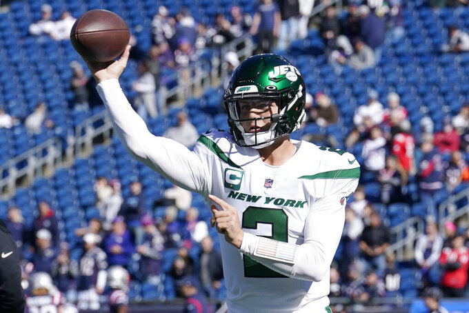 New York Jets quarterback Zach Wilson (2) throws prior to an NFL football between the New England Patriots and New York Jets, Sunday, Oct. 24, 2021, in Foxborough, Mass. (AP Photo/Steven Senne)