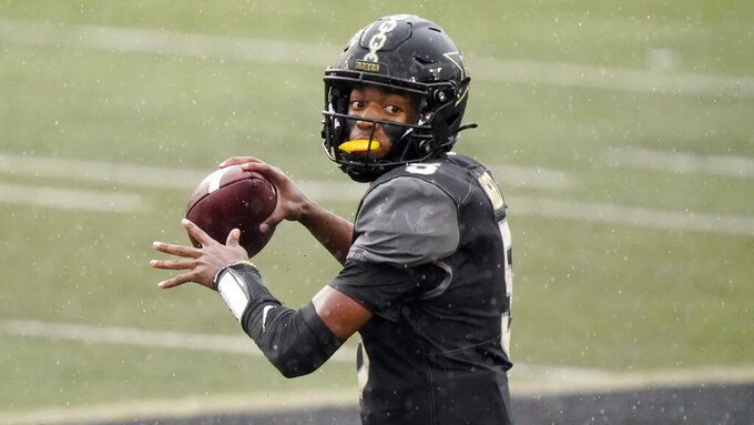 FILE — In this Oct. 10, 2020, file photo, Vanderbilt quarterback Mike Wright passes against South Carolina in an NCAA college football game in Nashville, Tenn. Wright is one of the quarterbacks hoping for a starting spot under new head coach Clark Lea. (AP Photo/Mark Humphrey, File)