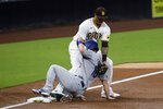 San Diego Padres third baseman Manny Machado applies a tag to Los Angeles Dodgers' Will Smith in the third inning of a baseball game Tuesday, Sept. 15, 2020, in San Diego. The Padres challenged the call of safe and it was over turned after review. (AP Photo/Derrick Tuskan)