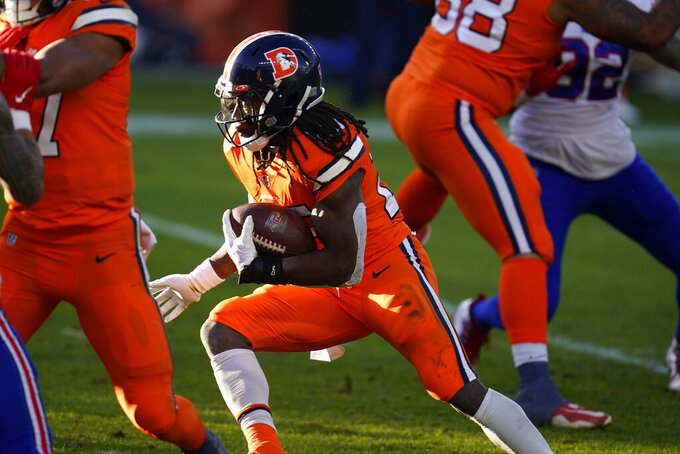 Denver Broncos running back Melvin Gordon III runs for a touchdown during the first half of an NFL football game against the Buffalo Bills, Saturday, Dec. 19, 2020, in Denver. (AP Photo/David Zalubowski)