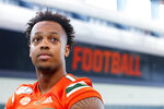FILE - In this, Tuesday, Aug. 13, 2019, file photo, Miami quarterback Jarren Williams waits to speak to members of the media during the team's Media Day in Coral Gables, Fla. Williams will make his first career start Saturday when Miami takes on Florida. (AP Photo/Wilfredo Lee, File)