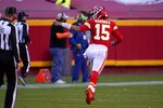 Kansas City Chiefs' Patrick Mahomes (15) celebrates throwing a touchdown pass to wide receiver Tyreek Hill in the second half of an NFL football game against the New York Jets on Sunday, Nov. 1, 2020, in Kansas City, Mo. (AP Photo/Jeff Roberson)