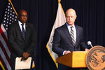 Kane County State's Attorney Joseph McMahon, right, and Attorney General Kwame Raoul speak during a news conference Monday, Feb. 11, 2019, in Chicago. Raoul and McMahon, who won the conviction against Jason Van Dyke, said they believe Judge Vincent Gaughan did not properly apply the law when he sentenced Van Dyke, the Chicago police officer who fatally shot black teenager Laquan McDonald,  to six years and nine months in prison. In a rare move, they filed a request with the Illinois Supreme Court seeking an order that would send the case back to Gaughan for a new sentence. (AP Photo/Noreen Nasir)