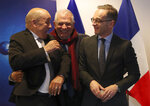 European Union foreign policy chief Josep Borrell, center, speaks with German Foreign Minister Heiko Maas, right, and French Foreign Minister Jean-Yves Le Drian, left, as they pose for a photo prior to a meeting to discuss the situation in Libya at the EEAS building in Brussels, Tuesday, Jan. 7, 2020. The ministers will also hold talks later Tuesday which are expected to center on the situation in Iran and Iraq. (AP Photo/Francisco Seco, Pool)