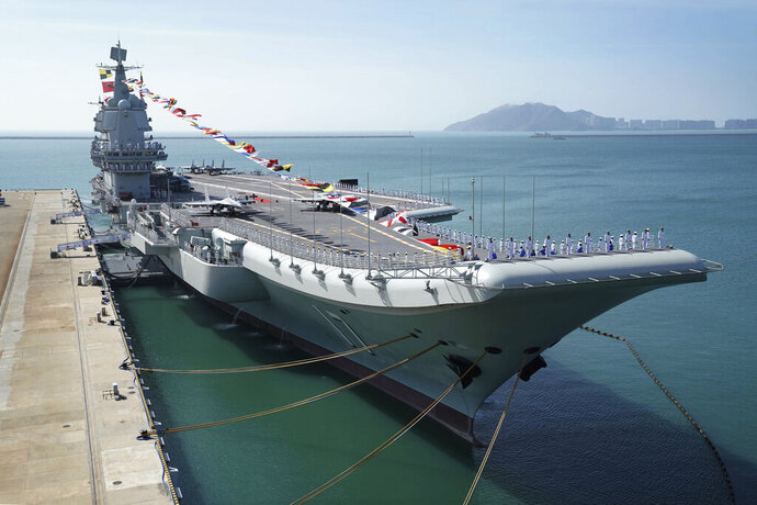 FILE - In this Dec. 17, 2019, file photo provided by Xinhua News Agency, the Shandong aircraft carrier is docked at a naval port in Sanya in southern China's Hainan Province. China's Defense Ministry said Friday, May 29, 2020, the navy's only entirely home-built aircraft is carrying out sea trials to test weapons and equipment and enhance training of the crew. (Li Gang/Xinhua via AP, File)