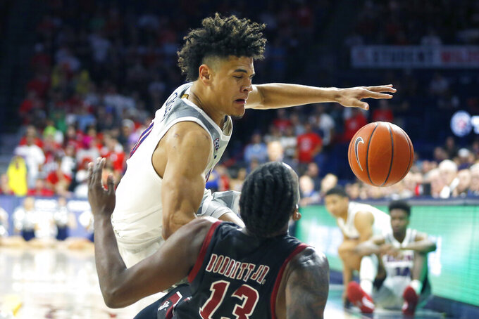Arizona guard Josh Green draws the foul on New Mexico State forward C.J. Bobbitt (13) in the second half during an NCAA college basketball game, Sunday, Nov. 17, 2019, in Tucson, Ariz. Arizona defeated New Mexico State 83-53. (AP Photo/Rick Scuteri)