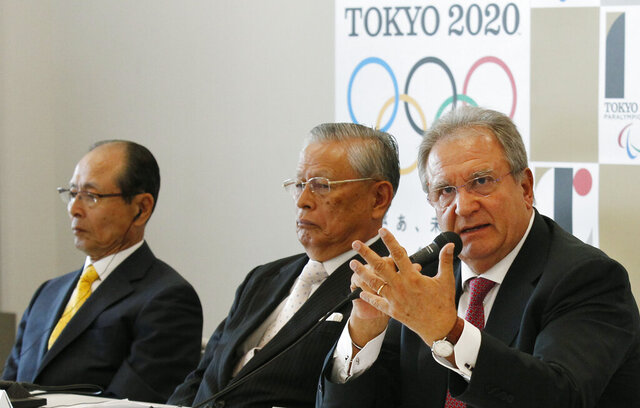 FILE - In this  Friday, Aug. 7, 2015 filer, World Baseball Softball Confederation President Riccardo Fraccari, right, accompanied by Japanese baseball legend Sadaharu Oh, left, and Nippon Professional Baseball Commissioner Katsuhiko Kumazaki, speaks to the media at a press conference in Tokyo. For World Baseball Softball Confederation president Riccardo Fraccari, it seems like such a sure home run that he can't even imagine why anyone wouldn't want to be involved. No wonder the refusal of Major League Baseball and its players' association to send top stars to the Tokyo Games has frustrated Fraccari for years. Now, with the Olympics postponed for a full year due to the coronavirus pandemic, and the current MLB season on hold, Fraccari has the unexpected opportunity to make one final pitch to the sport's biggest league. (AP Photo/Ken Aragaki, File)