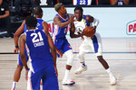 Indiana Pacers guard Victor Oladipo (4) handles the ball against Philadelphia 76ers guard Josh Richardson (0) during the second quarter of an NBA basketball game Saturday, Aug. 1, 2020, in Lake Buena Vista, Fla. (Kim Klement/Pool Photo via AP)
