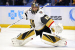Vegas Golden Knights goalie Marc-Andre Fleury (29) slides across the crease during the first period of an NHL hockey game against the Buffalo Sabres, Tuesday, Jan. 14, 2020, in Buffalo, N.Y. (AP Photo/Jeffrey T. Barnes)
