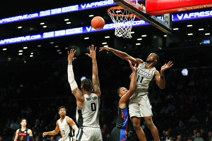 Providence guard Alpha Diallo (11) blocks the shot of Florida forward Kerry Blackshear Jr. (24) during the first half of an NCAA college basketball game at Barclays Center, Tuesday, Dec. 17, 2019, in New York. (AP Photo/Michael Owens)