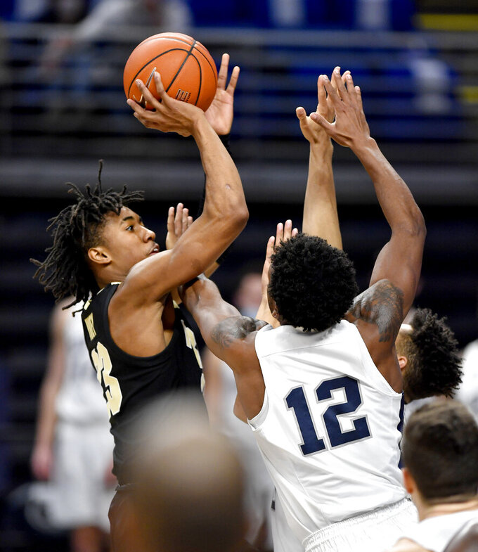 Purdue's Jaden Ivey shoots over Penn State defenders, including Izaiah Brockington (12), during an NCAA college basketball game Friday, Feb. 26, 2021, in State College, Pa. (Abby Drey/Centre Daily Times via AP)