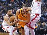 Utah Jazz's Bojan Bogdanovic (44) is fouled by Toronto Raptors' Fred VanVleet (23) during first half NBA basketball action in Toronto, Sunday, Dec. 1, 2019.  (Hans Deryk/The Canadian Press via AP)