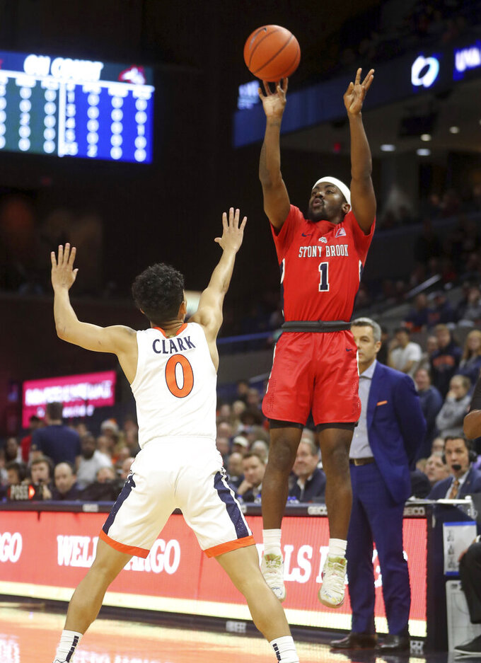 Stony Brook guard Makale Foreman (1) shoots over Virginia guard Kihei Clark (0) during an NCAA college basketball game in Charlottesville, Va., Wednesday, Dec. 18, 2019. (AP Photo/Andrew Shurtleff)