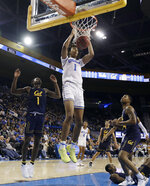 UCLA center Moses Brown (1) dunks against California during the second half of an NCAA college basketball game Saturday, Jan. 5, 2019, in Los Angeles. (AP Photo/Marcio Jose Sanchez)
