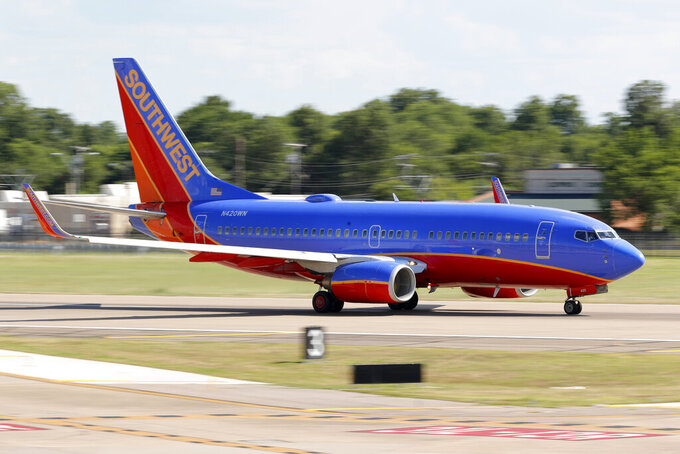 FILE - A Southwest Airlines jet takes off from Love Field in Dallas, Wednesday, June 24, 2020. Southwest Airlines says its workers must take pay cuts or face furloughs next year. CEO Gary Kelly said Monday, Oct. 5, 2020 that Southwest needs to cut spending sharply or risk losing billions of dollars every three months. (AP Photo/Tony Gutierrez)