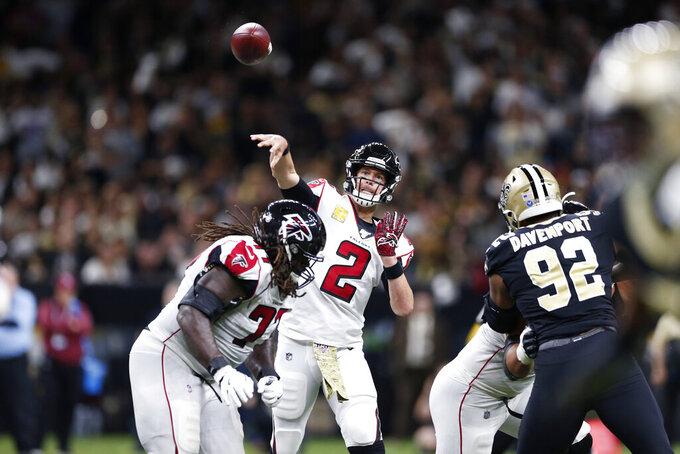 Atlanta Falcons quarterback Matt Ryan (2) passes under pressure from New Orleans Saints defensive end Marcus Davenport (92) in the first half of an NFL football game in New Orleans, Sunday, Nov. 10, 2019. (AP Photo/Rusty Costanza)
