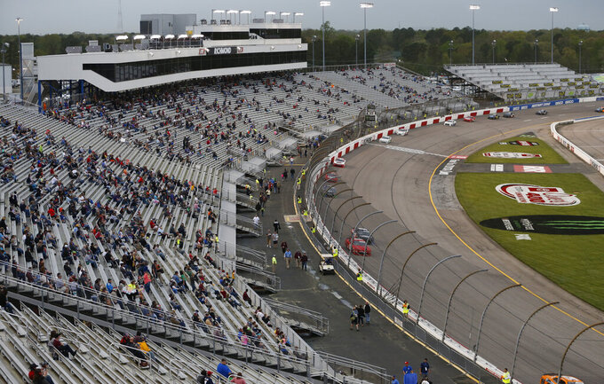 Fans watch the start of the NASCAR Xfinity Series auto race at Richmond Raceway in Richmond, Va., Friday, April 12, 2019. (AP Photo/Steve Helber)