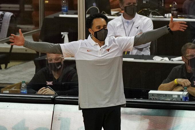 Texas head coach Shaka Smart directs his team against Oklahoma State during the first half of an NCAA college basketball game in Austin, Texas, Sunday, Dec. 20, 2020. (AP Photo/Chuck Burton)