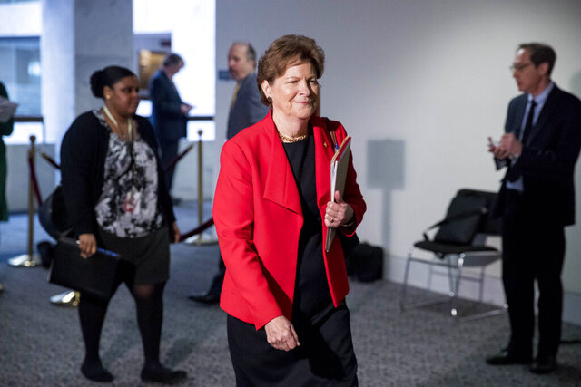 Sen. Jeanne Shaheen, D-N.H., arrives for a meeting to discuss the coronavirus relief bill on Capitol Hill, Friday, March 20, 2020, in Washington. (AP Photo/Andrew Harnik)