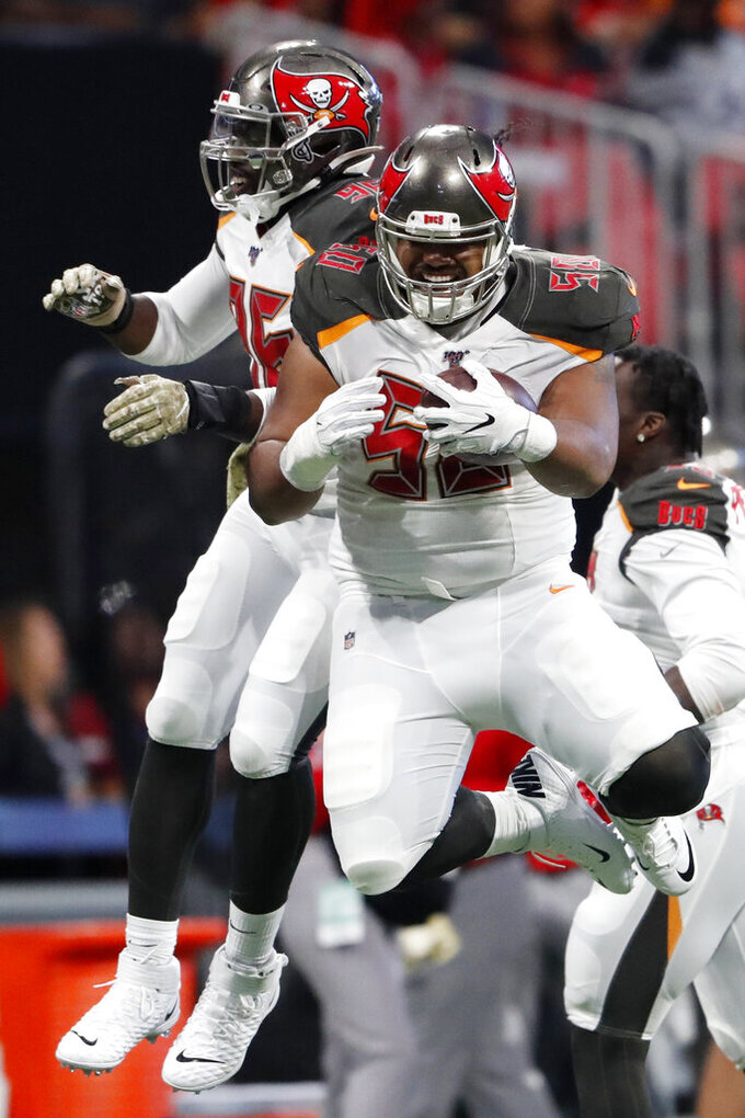 Tampa Bay Buccaneers linebacker Sam Acho, left, celebrates Tampa Bay Buccaneers defensive tackle Vita Vea's touchdown against the Atlanta Falcons during the first half of an NFL football game, Sunday, Nov. 24, 2019, in Atlanta. (AP Photo/John Bazemore)