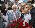 Mike Smith celebrates after riding Justify to victory with trainer Bob Baffert, left, during the 144th running of the Kentucky Derby horse race at Churchill Downs Saturday, May 5, 2018, in Louisville, Ky. (AP Photo/John Minchillo)