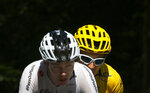 Britain's Geraint Thomas, wearing the overall leader's yellow jersey and Britain's Chris Froome ride during the twelfth stage of the Tour de France cycling race over 175.5 kilometers (109 miles) with start in Bourg-Saint-Maurice Les Arcs and Alpe d'Huez, France, Thursday, July 19, 2018. (AP Photo/Peter Dejong)