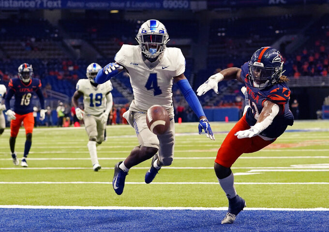Middle Tennessee cornerback Quincy Riley (4) breaks up a pass intended for UTSA wide receiver Joshua Cephus (12) during the second half of an NCAA college football game Friday, Sept. 25, 2020, in San Antonio. (AP Photo/Eric Gay)