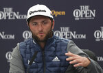 Spain's Jon Rahm answers a question from the media during a press conference ahead of the start of the British Open golf championships at Royal Portrush in Northern Ireland, Wednesday, July 17, 2019. The British Open starts Thursday. (AP Photo/Jon Super)