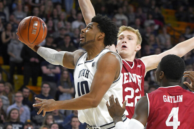 Utah State forward Alphonso Anderson (10) takes a shot as Denver forward Tristan Green (22) and guard Taelyr Gatlin (4) defend during the first half of an NCAA college basketball game Tuesday, Nov. 12, 2019, in Logan, Utah. (AP Photo/Eli Lucero)
