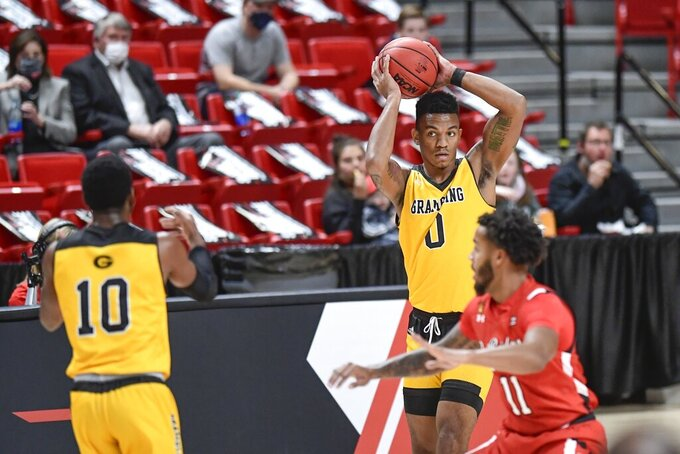 Grambling State's Cameron Woodall (0) passes the ball against Texas Tech in the first half of an NCAA college basketball game in Lubbock, Texas, Sunday, Dec. 6, 2020. (AP Photo/Justin Rex)