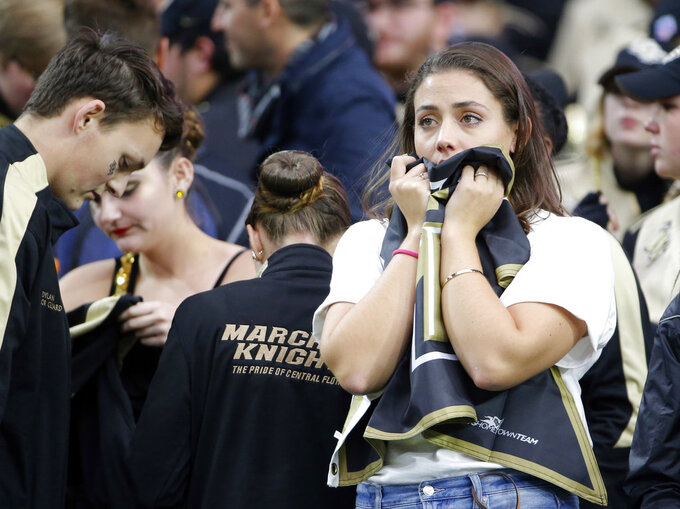 UCF fans react after the Fiesta Bowl NCAA college football game against between LSU and UCF, Tuesday, Jan. 1, 2019, in Glendale, Ariz. LSU defeated UCF 40-32. (AP Photo/Rick Scuteri)