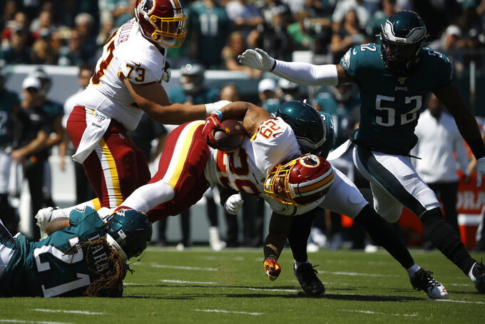 Washington Redskins' Derrius Guice (29) is tackled by Philadelphia Eagles' Rodney McLeod (23) and Ronald Darby (21) during the first half of an NFL football game, Sunday, Sept. 8, 2019, in Philadelphia. (AP Photo/Matt Rourke)